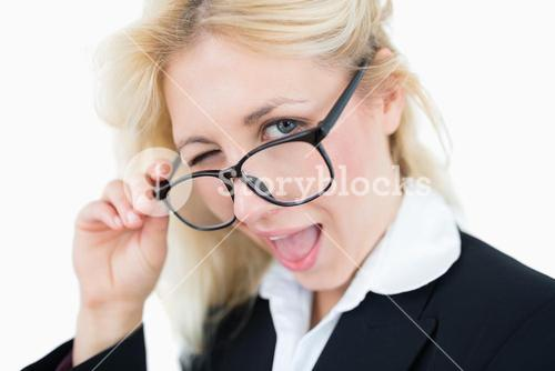 Closeup portrait of beautiful business woman winking