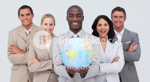Businessman holding a terrestrial globe with his team