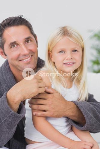 Smiling father hugging his daughter