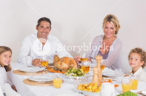 Family sitting on table to eat