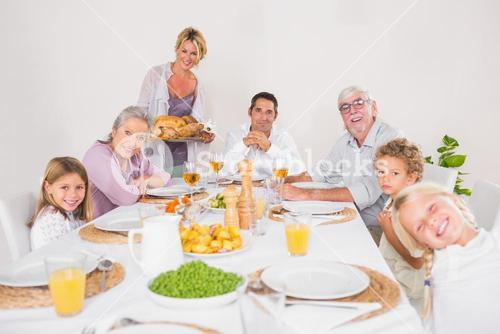 Woman holding a turkey for family dinner