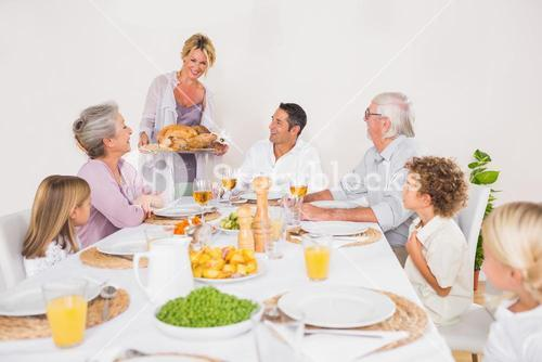 Family watching the roast turkey