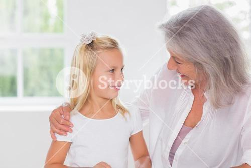 Smiling grandmother talking with her granddaughter
