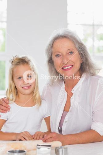 Grandmother and granddaughter looking at camera