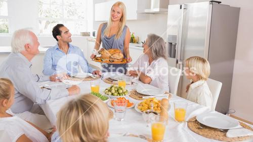 Mother serving the turkey
