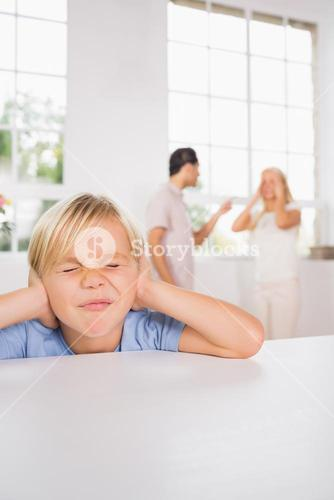 Little boy looking sad cause of parents