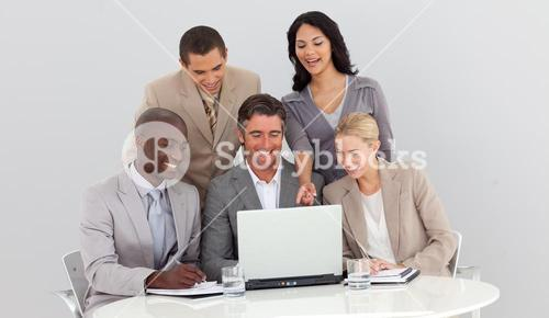 Business team studying sales figures