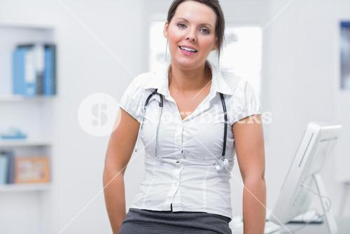 Confident female doctor at clinic