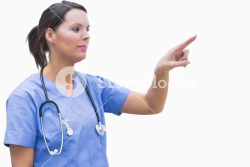 Female surgeon pointing at invisible screen