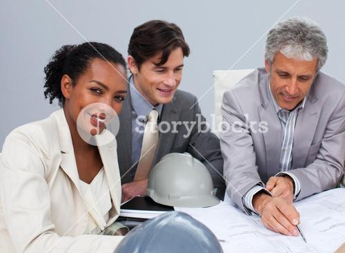 Female engineer studying plans in a meeting