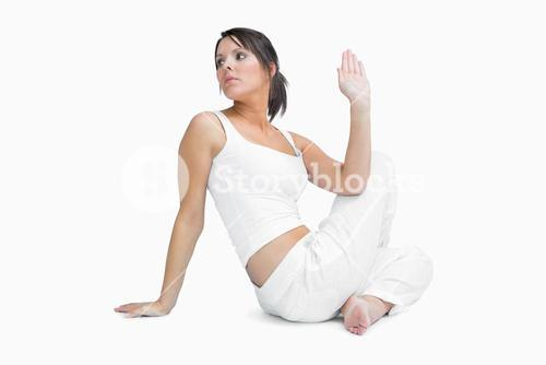 Young woman sitting in yoga position