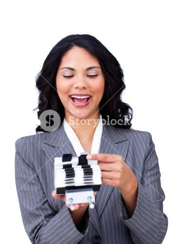 Enthusiastic businesswoman consulting a business card holder