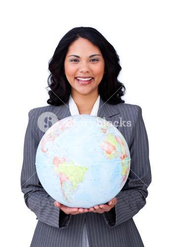 Visionary young businesswoman smiling at global business