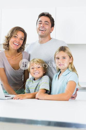 Cheerful family standing in kitchen