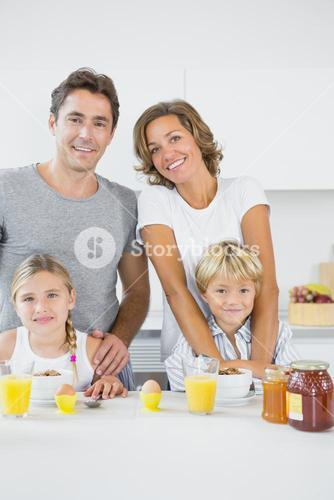 Smiling family at breakfast