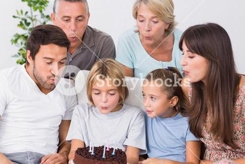 Little boy blowing out birthday candles