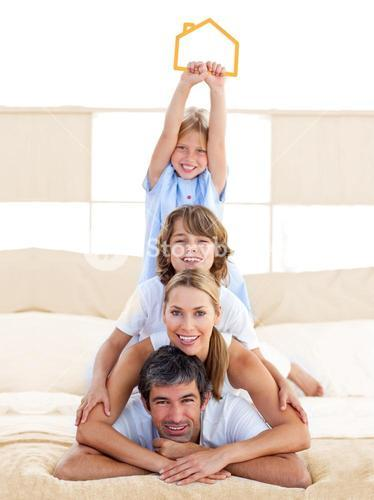Jolly family having fun with yellow house illustration