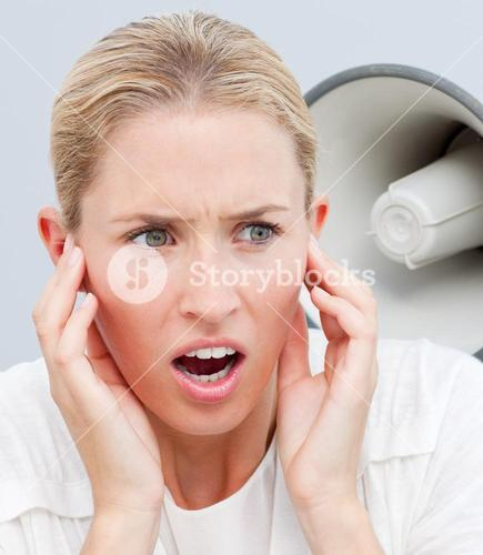 Portrait of someone shouting through a megaphone in a womans ears