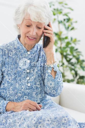 Elderly cheerful woman on a mobile phone