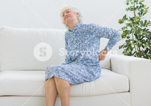 Elderly woman suffering with back pain