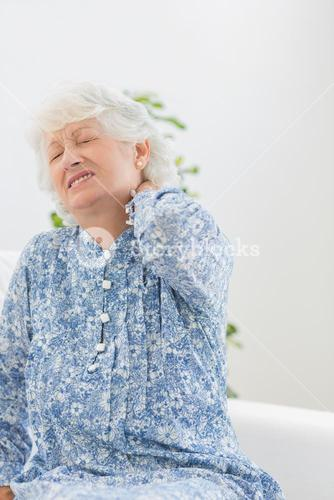 Elderly woman suffering with a neck pain