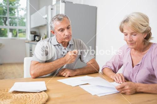 Couple reading documents together