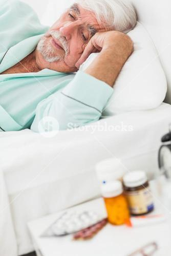 Elderly man waking up