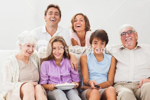 Multigeneration family on couch watching tv