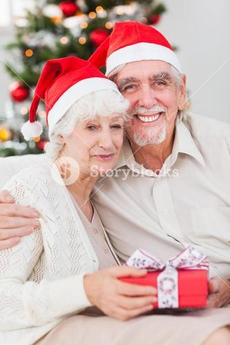 Happy couple on the couch at christmas