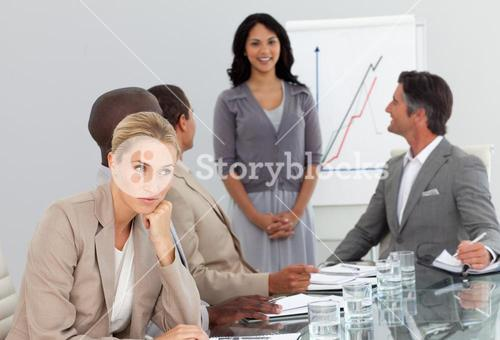 woman bored at a presentation