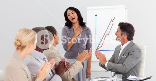 Business people clapping at a presentation