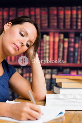 Cute girl writing with book