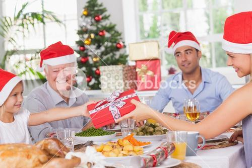 Mother giving daughter christmas present
