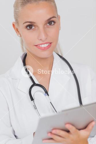 Happy doctor using tablet