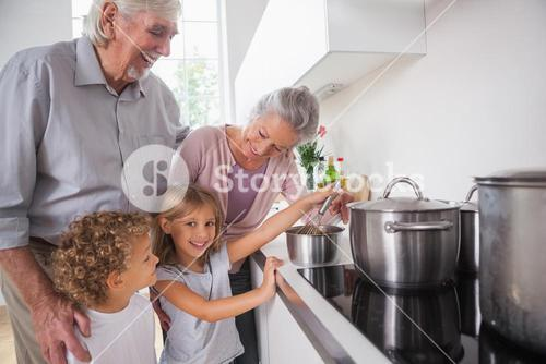 Children cooking with grandparents