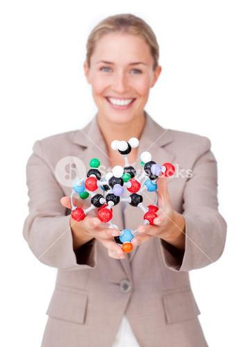 Smiling businesswoman holding a molecule