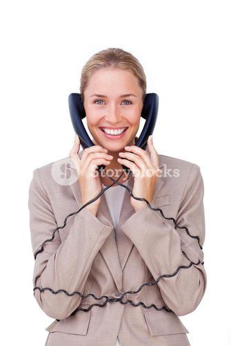 Cute female sales representative talking on headset