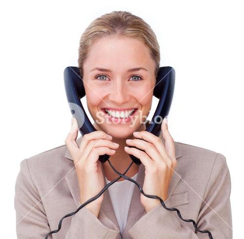 Beautiful female sales representative talking on headset