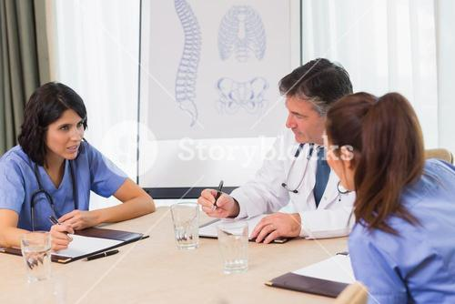 Nurses and doctors in a meeting