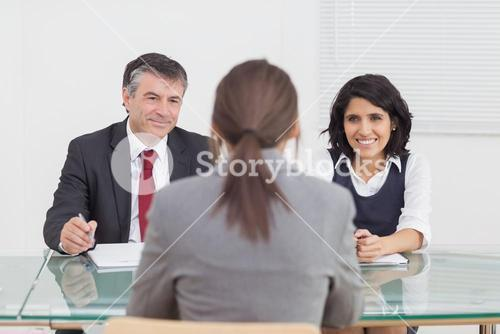 Business people talking and smiling in a small meeting