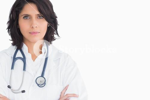 Pretty doctor with a stethoscope and arms crossed