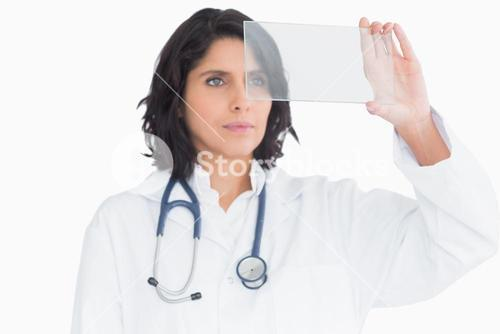 Doctor examining virtual screen