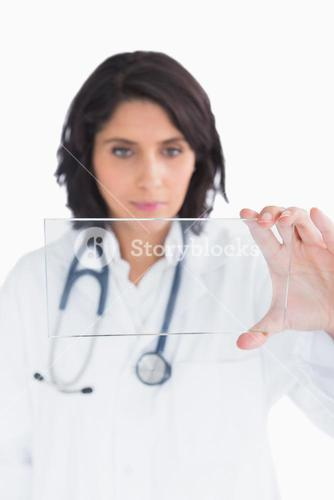 Doctor looking at virtual clear screen