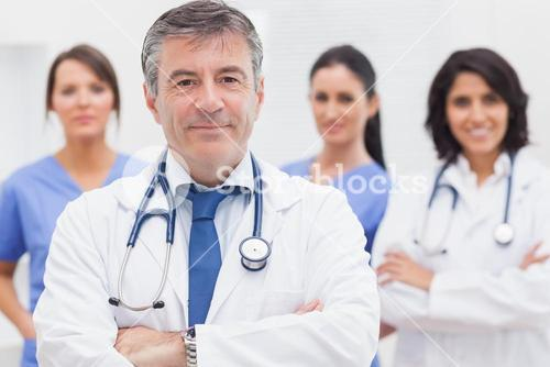 Doctor and his team smiling