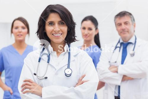 Female doctor and her team smiling