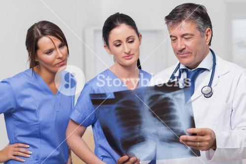 Doctor and nurses looking xray