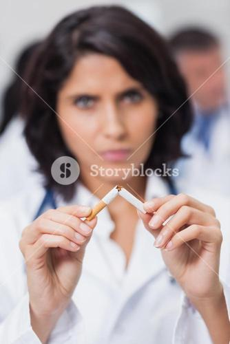 Doctor breaking cigarette