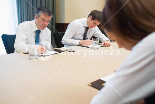 Business people writing notes