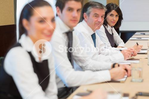 Smiling business people in a row