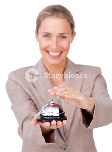 Smiling businesswoman holding a service bell